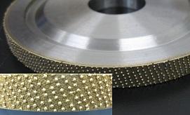 Single-layered metal bonded diamond wheel with uniformly arranged abrasives